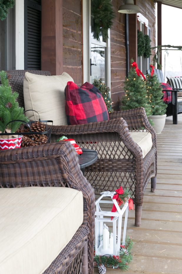 Christmas Porch Tour Of A Rustic Log Home Using Buffalo Check Fabric in Red and Black With Natural Pine Branch Galrland