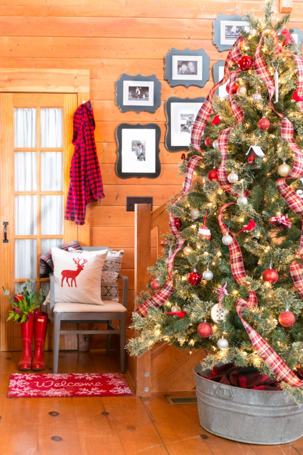 Plaid Christmas Tree in a Log Home Done In Traditional Colors of Red, Gold, Silver, and Black