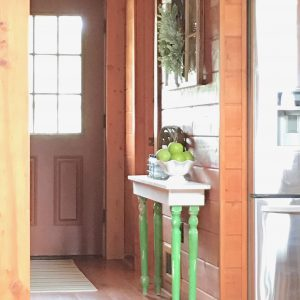 DIY Entryway Table Made Using Salvaged Table Legs And an Old Farmhouse Sign