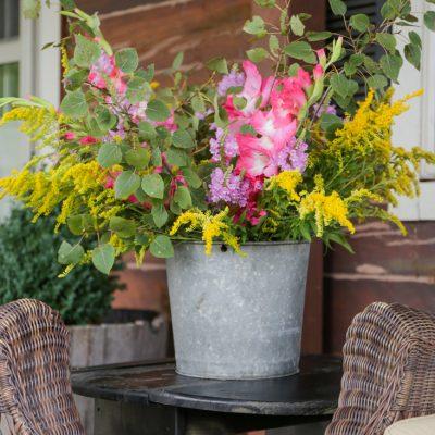 Rustic Galvanized Bucket of Wildflowers and Gladiolas