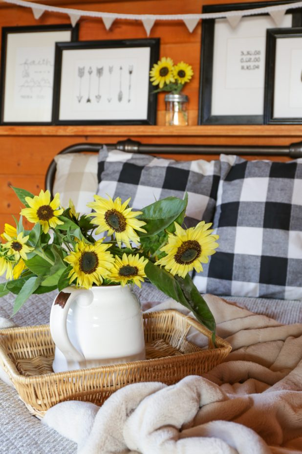 Decorating a Guest Room Using Buffalo Check Fabric, Sunflowers, Ticking, Black and White Art Prints, and a Bunting For Fall
