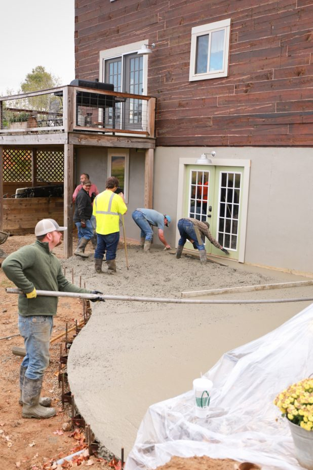 Pouring a concrete patio and fire pit at a log home