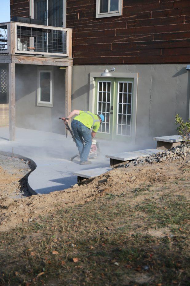 Saw cutting concrete patio