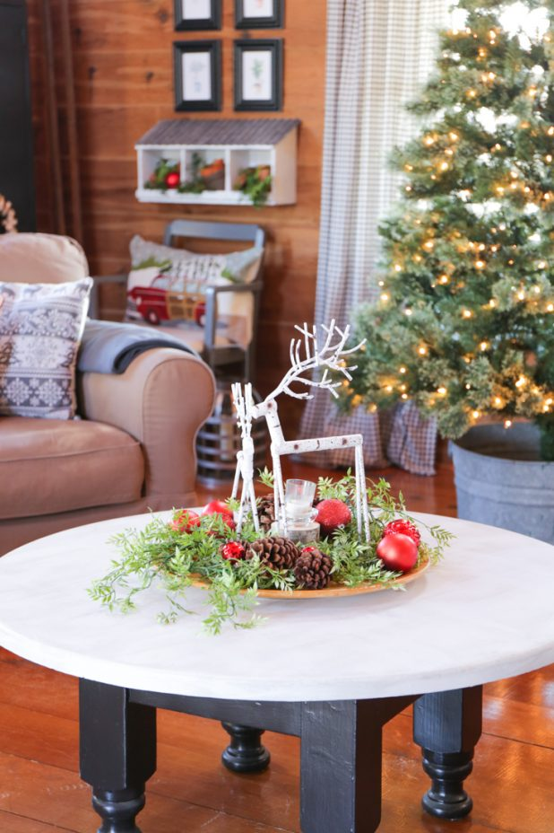 Easy Coffee Table Vignette Using a Wooden Tray, Greenery, Pinecones, Ornaments, Candle and Birchwood Deer