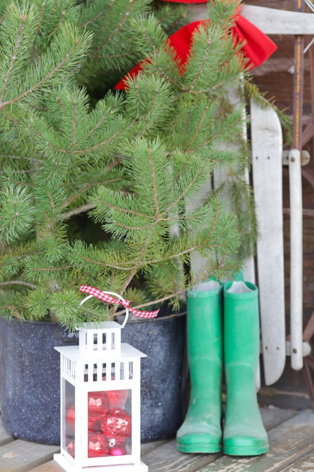 Rustic Log Home Christmas Porch, Fresh Cut Pines, Vintage Red Wagon, Grapevine Wreath, Pine Clippings, Boots, and Galvanized Buckets, How To Preserve Pine Branches