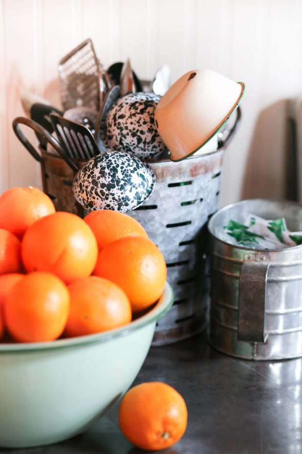 Fresh Oranges in a Green Enamelware Bowl, Vintage Flour Sifter, Olive Bucket to Store Utensiles