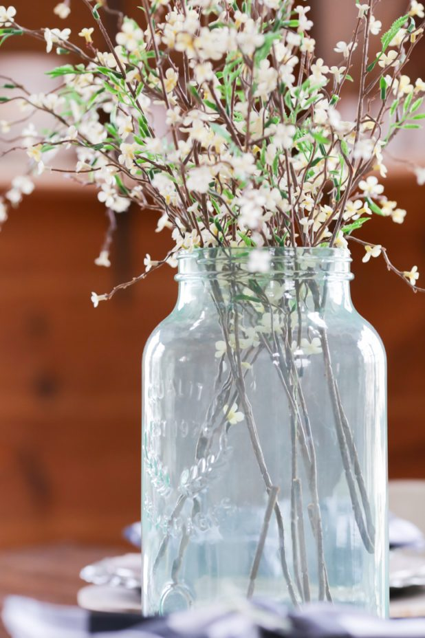 Large Green Mason Jar Filled With Fresh Blooming Branches