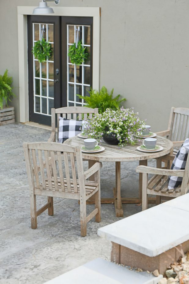 African Teek Outdoor Patio Furniture, Alfresco Dining, Stamped Concrete Patio, Buffalo Check Patio Pillows, Black and White, Boxwood Wreath, Painted Basement Walls, Farmhouse Style, Log Home, Country Living.