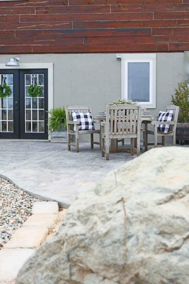 Teek Patio Furniture, Stamped Concrete Patio, Black and White, Buffalo Check, Log Home, Country Living, Farmhouse Style, French Doors, Painted Basement Walls.