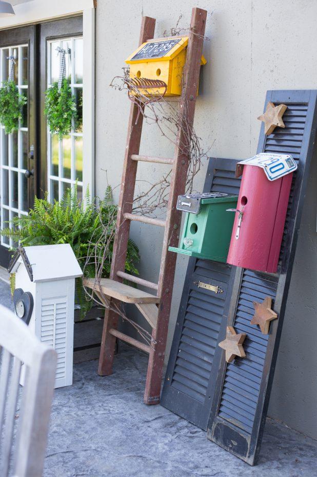 Birdhouses Made From Junk. Garden Sculpture Art, Junk Art, Birdhouse Art. Made From License Plates, Scrap Lumber, Farmhouse Ladder, Door Knobs, Silverware, and Shutters.