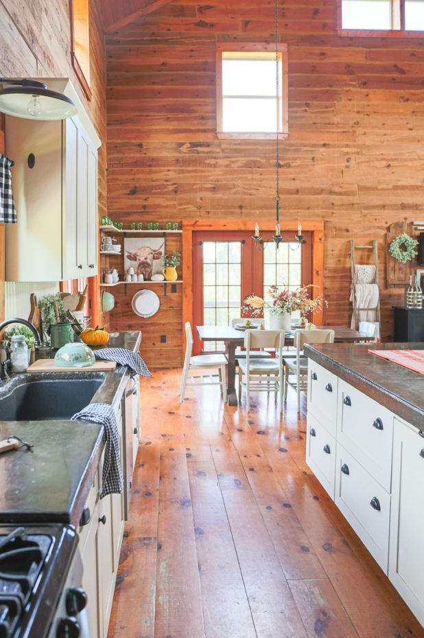 Simple Farmhouse Touches Added To a Rustic Log Home Kitchen For Fall Using Only Pumpkins To Decorate