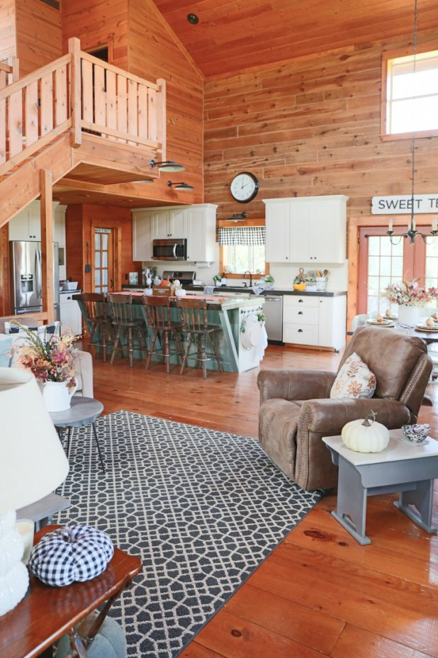 Rustic Farmhouse Charm Can Be Found In This Log Cabin. Fall Decorating Using Natural Elements and Keeping It Simple With Pumpkins