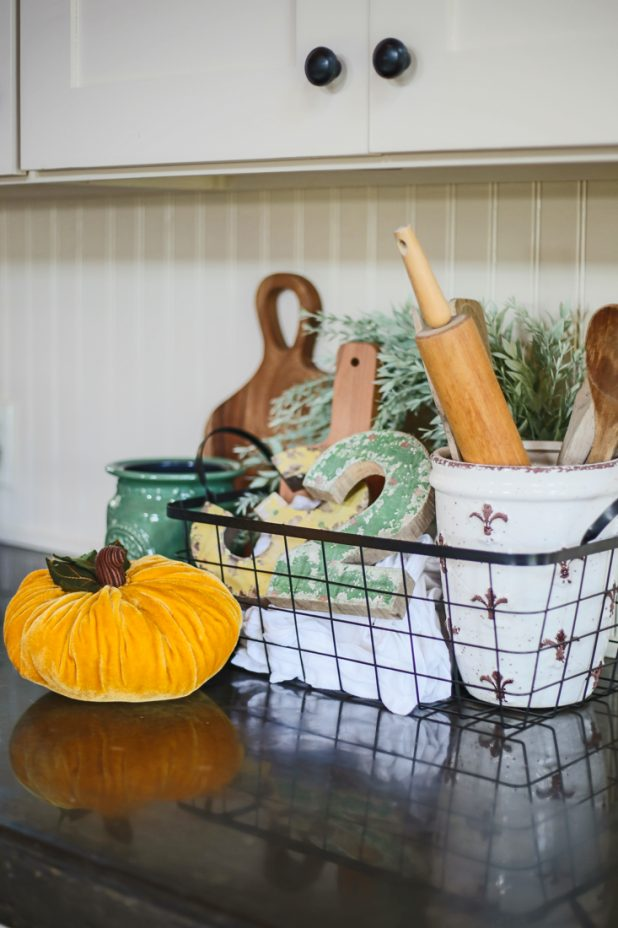 Decorating a Log Home Kitchen For Fall With Pumpkins
