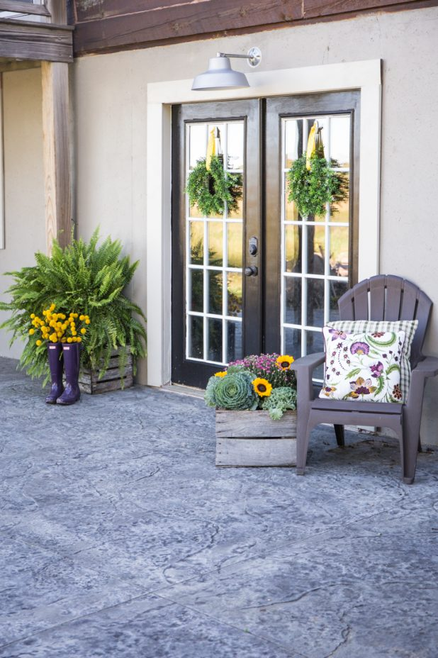 Fall French Door Entrance Using Purple, Gold, and Green. Mums, Sunflowers, and Decorative Cabbage Plants