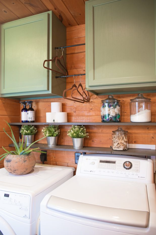 Small Laundry Room With Open Shelves and Painted Cabinets in Privilege Green From Sherwin Williams