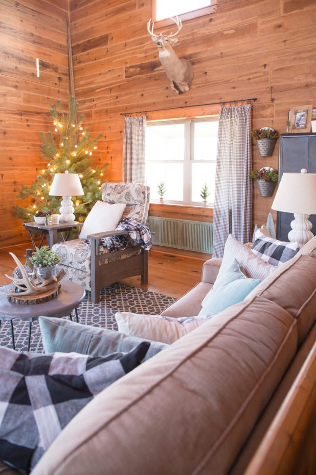 Rustic Log Cabin Christmas Decor Using Black and White Buffalo Check Paired With Green. Wood Tones, Deer Antlers, Galvanized Metal, Natural Decor