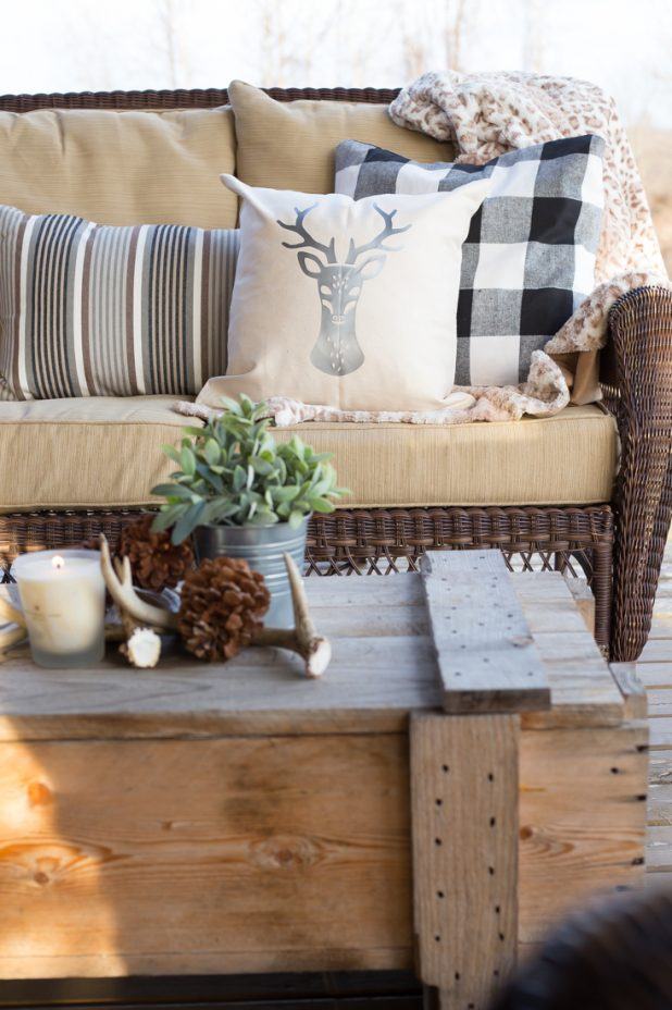 Winter Porch, Buffalo Check, Deer Pillow, Antlers, Pinecones, Candles and a Cozy Animal Print Throw. Log Home, Log Cabin Porch