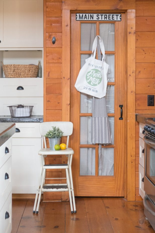 Curtain on Pantry Door, Farmhouse Style, Log Home, Cabin, Vintage Step Stool, White Cabinets, Concrete Countertops