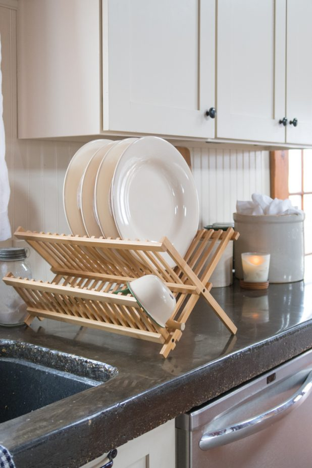 Farmhouse kitchen, Concrete countertops, White Cabinets, White Dishes, Enamelware, Wooden Dish Strainer