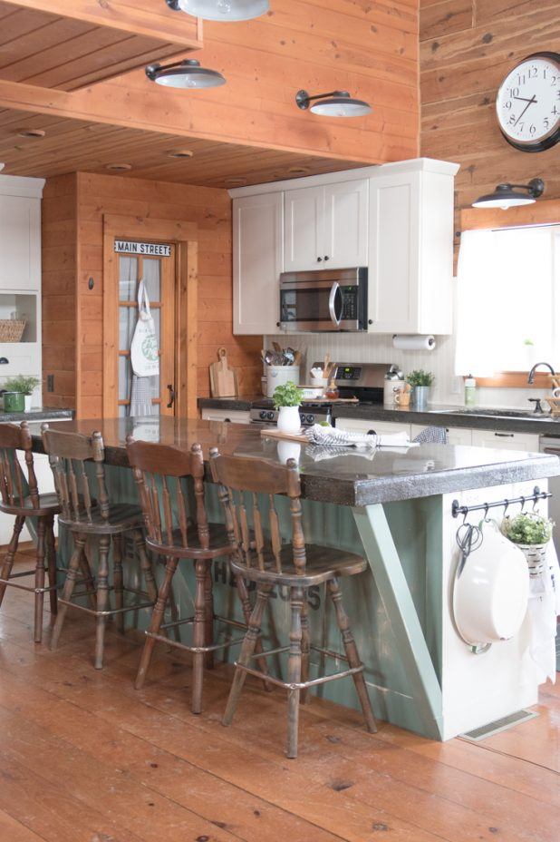 Log Home Kitchen, Painted White Cabinets, Stainless Steel Appliances, Pantry, Farmhouse Style, Barn Light Fixtures, Black Concrete Countertops