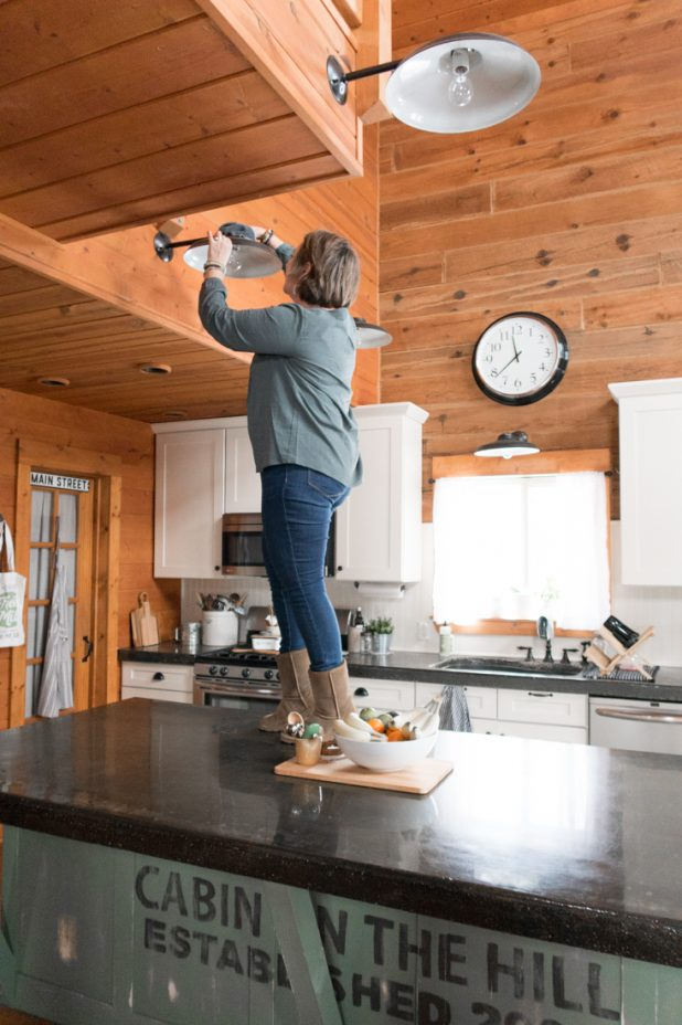 Cleaning Kitchen Lighting, Log Cabin Kitchen, Log Home Kitchen, Green Kitchen Island, Concrete Countertops, White Kitchen Cabinets