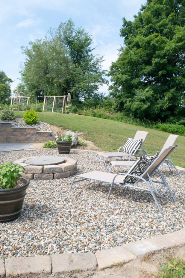 Outdoor lounge chairs around the fire pit, black and white accents, container garden