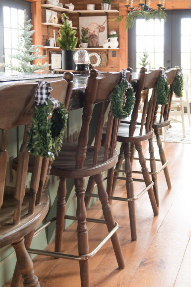 Christmas Kitchen, Log Home Christmas Kitchen, Wreathes on Chairs, Wide Plank Wood Floors, Concrete Countertop, Green Painted Island, Farmhouse Style