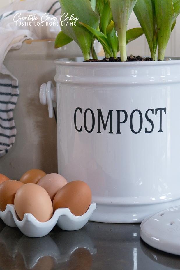 Stylish Countertop Compost Bin, Farm Fresh Eggs, Striped Linen, Blooming Tulips, Concrete Countertops, White Cabinets, Beadboard Backsplash