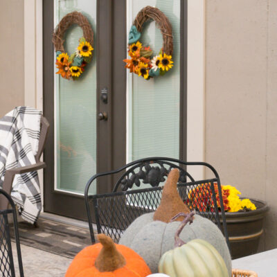 Fall Decorating On The Walkout Basement Concrete Patio