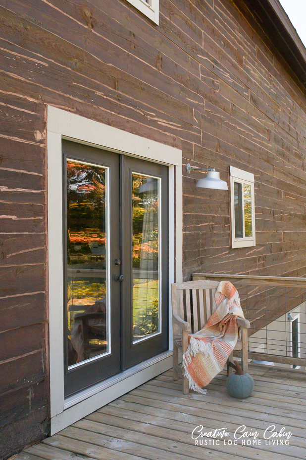 Log Home, Black Painted French Doors, Farmhouse Light, Deck With Hog Panel Railing