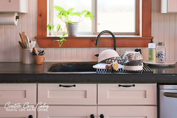 Log Home Kitchen, Dishwashing By Hand, Space Saving Dish Strainer, Neutral Dishes, Concrete Countertop, Beadboard, White Cabinets, Rustic Decor