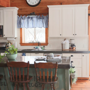 Log Cabin Kitchen With Blue and Green Decor