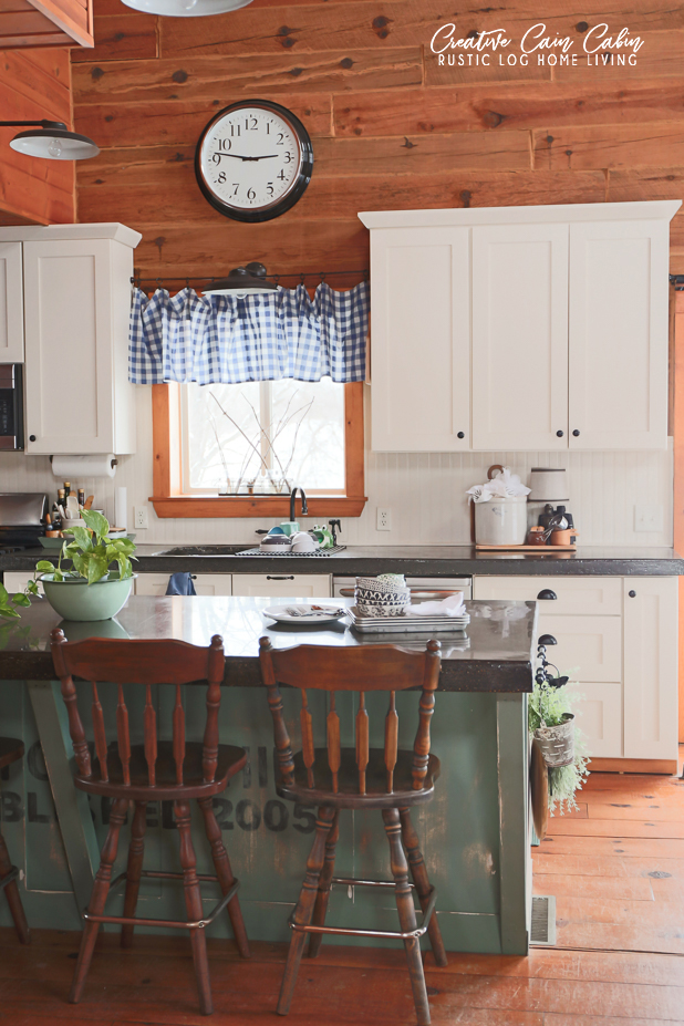 Kitchen, Log Home, White Cabinets, Beadboard, Concrete Countertops, Green Painted Island, Buffalo Check, Blue and Green Decor, Stainless Appliances, Wide Plank Pine Floors